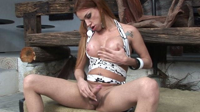 red-haired-shemale-carol-vendremini-touching-her-sexy-tits-with-lust_01