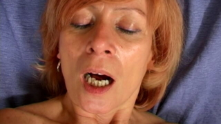 Redheaded granny Lady toying her hairy pussy hard on the couch