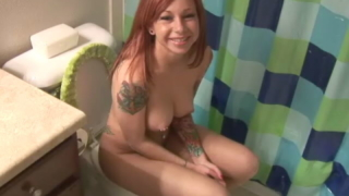 Redheaded teen in tattoos Pain pissing in the toilet