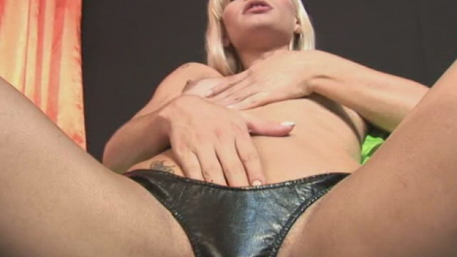 salacious-blonde-tranny-thays-schiavinato-touching-her-small-breasts-and-playing-with-her-hard-cock_01
