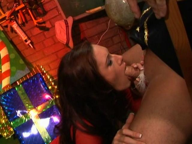Santa's little helper Taylor Rain gives this naughty Elf a great blowjob