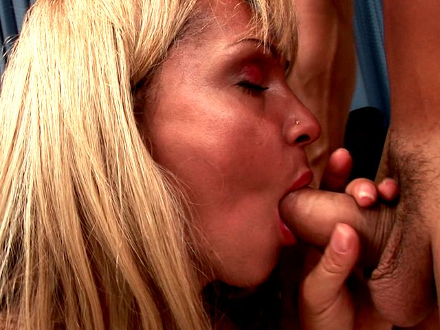 Seductive blonde shemale hoe Dayanne masturbating cock while giving blowjob