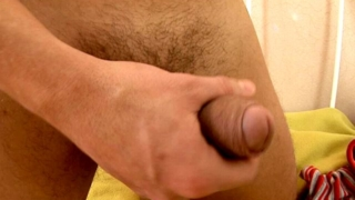 Seductive brunette european twink Jerome stroking his monster cock on the camera
