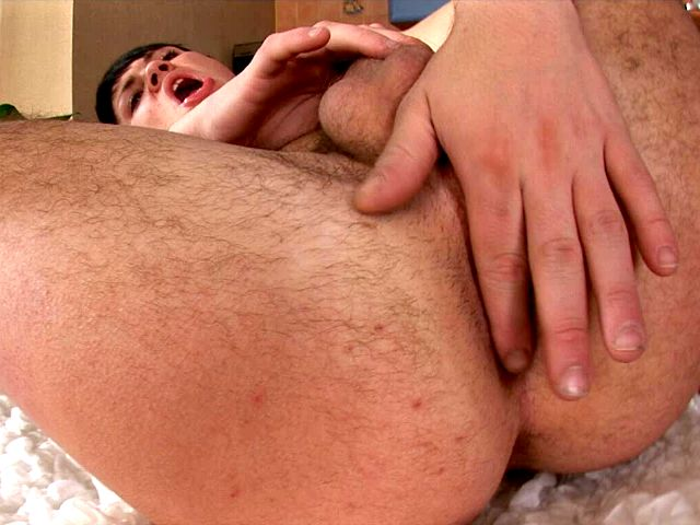 Seductive brunette gay Paul masturbating his sexy shaved asshole and hard penis on the camera