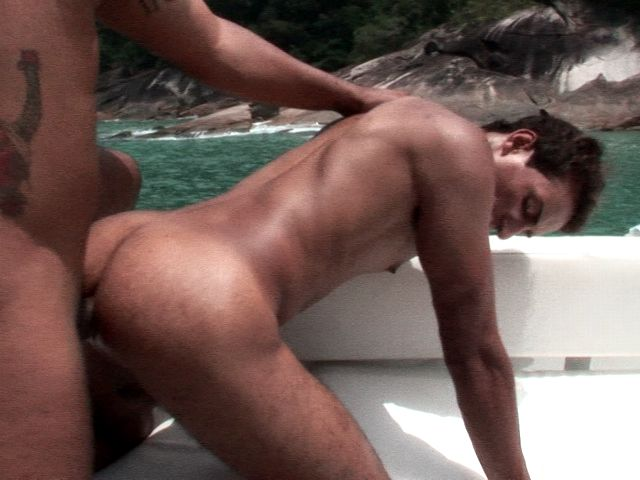 Sensational bronzed gay Alan getting booty smashed doggie by Matheus on the boat