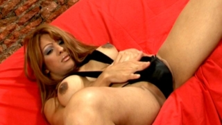 Sensual chesty tranny in high heels Morena playing with her tits and asshole on the couch