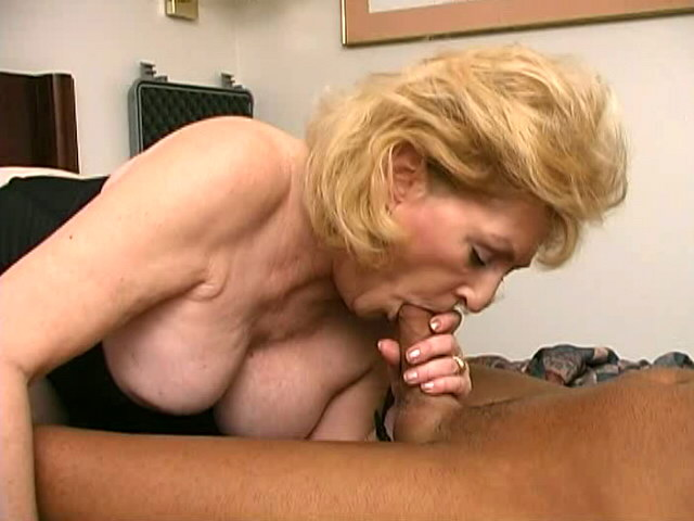 Sexual granny with giant tits Kitty Fox slurps a massive young penis Is That Grandma XXX Porn Tube Video Image