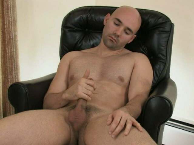 Sexy bald gay Bucky jerking his giant dick on the armchair Gay Sex Exposed XXX Porn Tube Video Image
