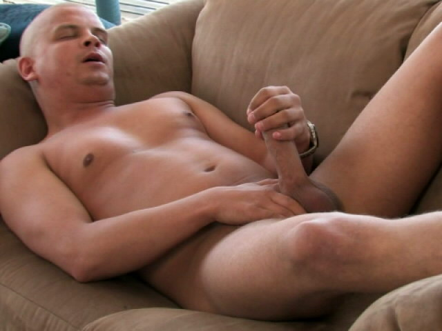 Sexy bald gay Lance rubbing his immense schlong on the couch Gay Sex Exposed XXX Porn Tube Video Image