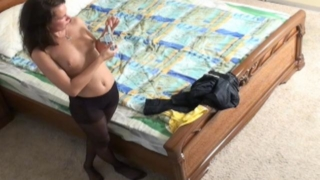 Sexy brunette voyeur babe Veranika posing in her nylons