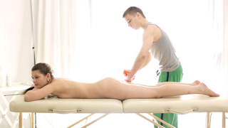 Sexy Nina enjoys laying on the massage table with the therapists cock inside her.
