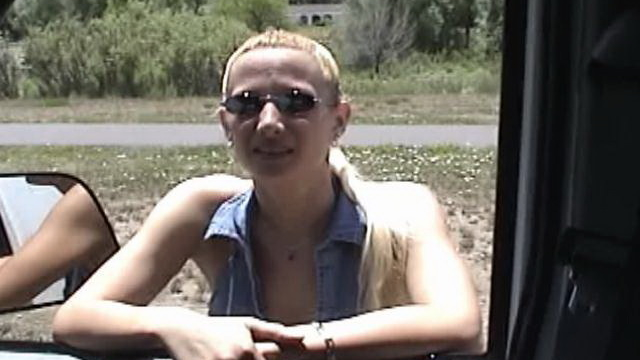 shameless-blonde-amateur-slut-showing-her-big-tits-to-a-driver-outdoors_01-1