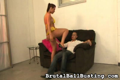 She feels the vibrations in her cunt. Brutal Ball Busting XXX Porn Tube Video Image