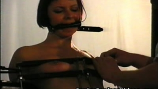short haired brunete with mouth strapped