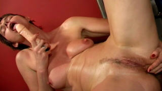 Short haired brunette grandma Marketa dildos ass and rubs her pussy
