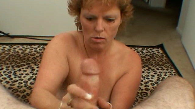 Short-haired-hottie-granny-megan-wanking-a-massive-cock-on-her-knees_01