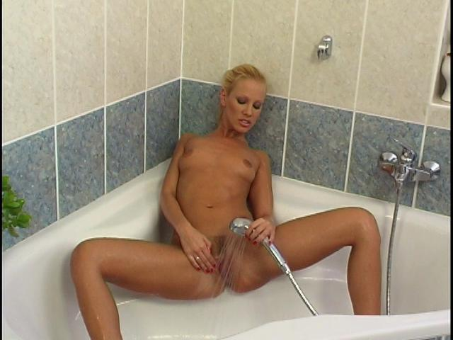 Sinfully blonde Czech angel washing her delicious pink pussy in the bath tube