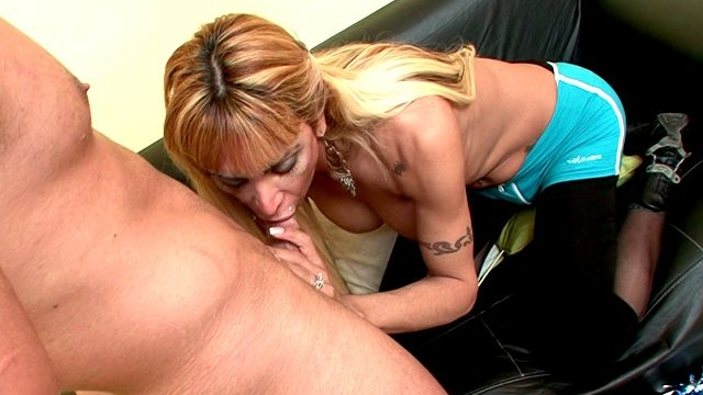 Sinfully-blonde-shemale-cheerleader-celeste-sucking-a-massive-penis-with-lust-on-the-couch_01