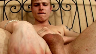Sinfully Tattooed Blonde Gay Derec Masturbating His Enormous Cock On The Camera