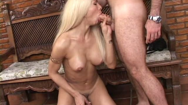 Sizzling-blonde-tranny-bitch-giving-blowjob-and-masturbating-her-hard-shaft_01-1