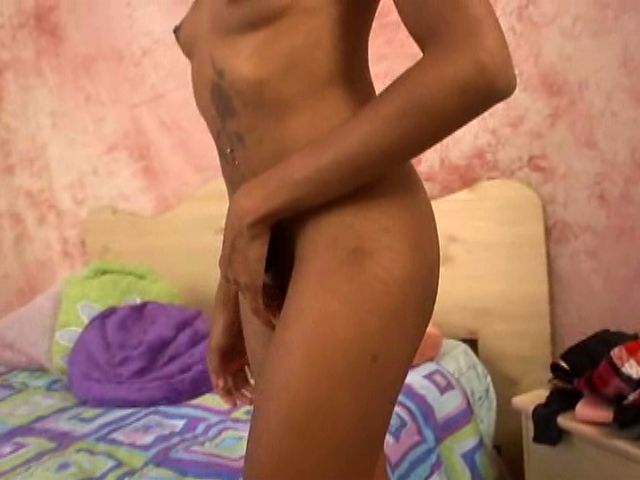 Skinny and tattooed young black girlfriend stripping and showing her assets in bedroom
