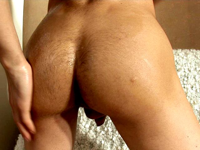 Skinny brunette gay Robert oiling and dildoing his tight butthole on camera