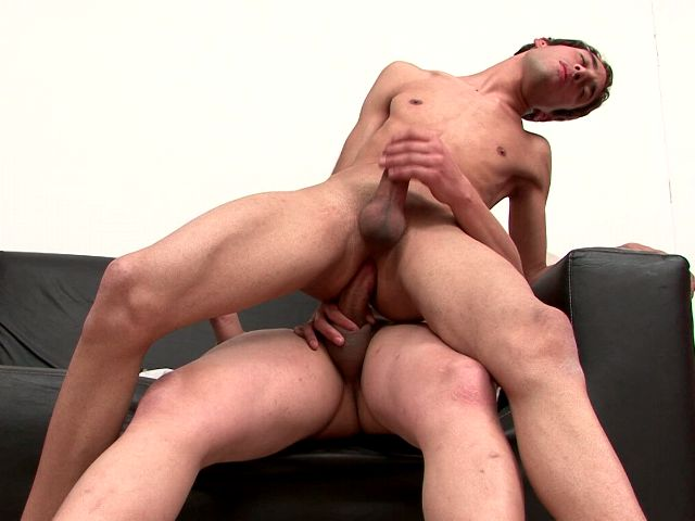 Skinny brunette twink Ariel riding anally Juanjo's big hard pecker on the couch