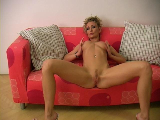 Slim blonde pornstar Lucycat spreads long legs and shows her pink snatch