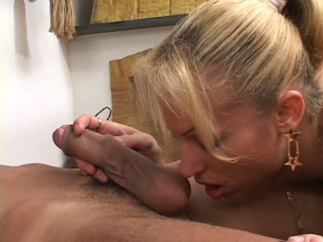 Slutty blonde tranny babe licking and sucking a big schlong with lust