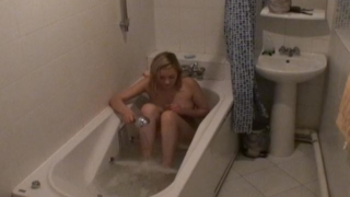 Slutty blonde voyeur vixen Marina washing her sexy body on the spy camera