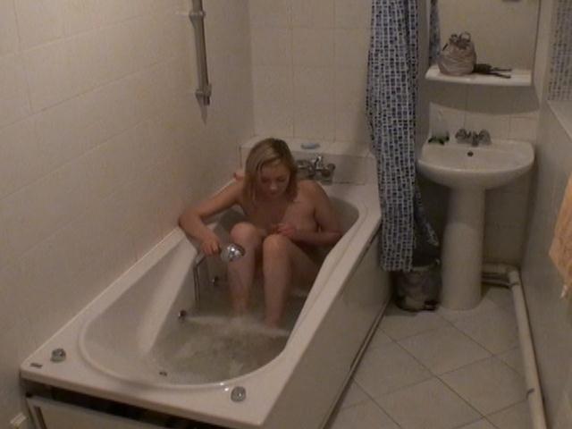 Slutty blonde voyeur vixen Marina washing her sexy body on the spy camera