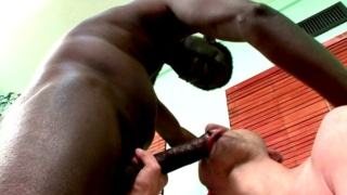 Slutty brunette gay Enok gets sensual pink mouth fucked deep by Canu's gigantic black penis
