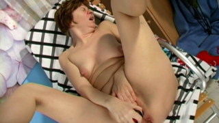 Slutty short haired grandma Anna fucking a massive dildo