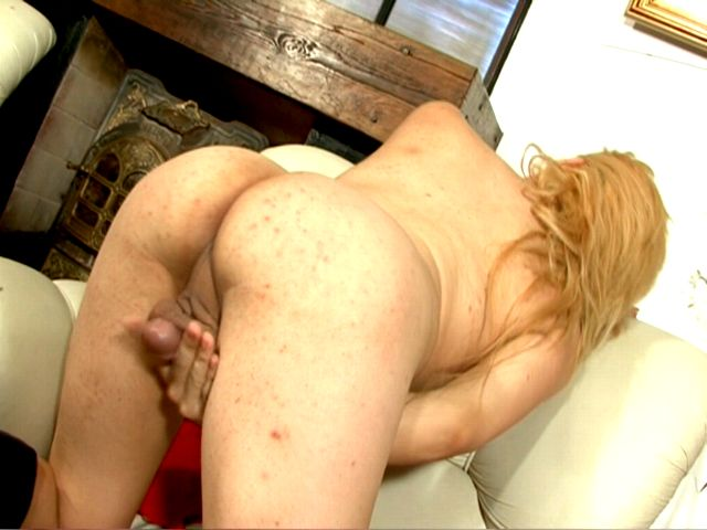 Small boobed blond tranny babe Celeste fingering her asshole on the camera