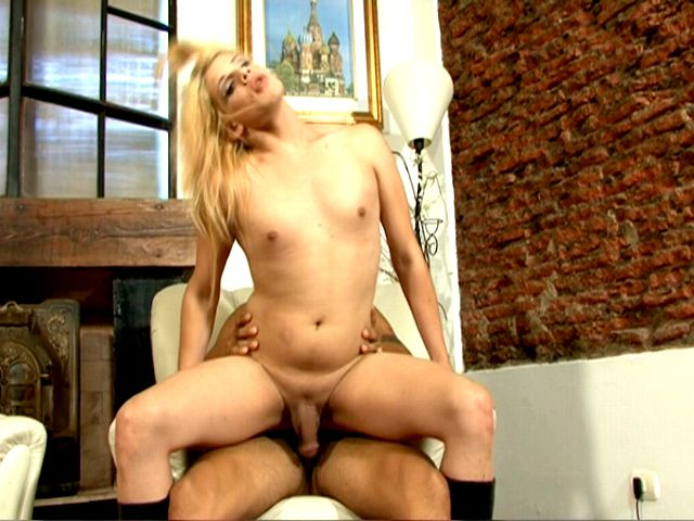 Small breasted blonde tranny whore Celeste riding a monster penis on armchair