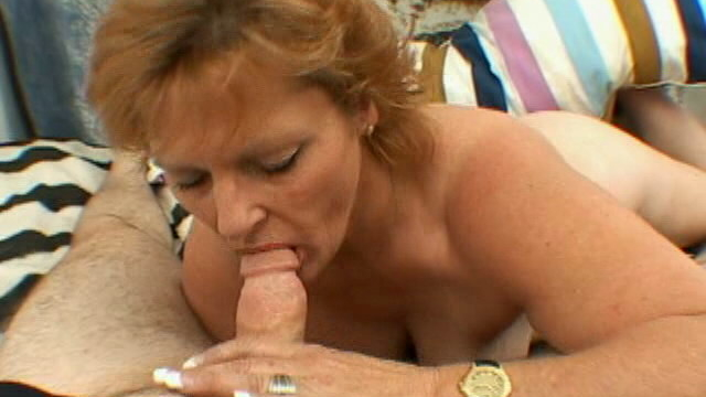 smiling-blonde-granny-with-big-tits-megan-strips-and-slurps-a-thick-penis_01