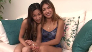 Smiling young asian cuties Aliyah And Lyla Lei teasing with their small tits on the couch