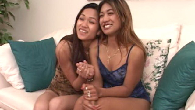 Smiling-young-asian-cuties-aliyah-and-lyla-lei-teasing-with-their-small-tits-on-the-couch_01-2
