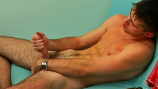 Spirited brun ette gay masturbating his large schlong on the couch