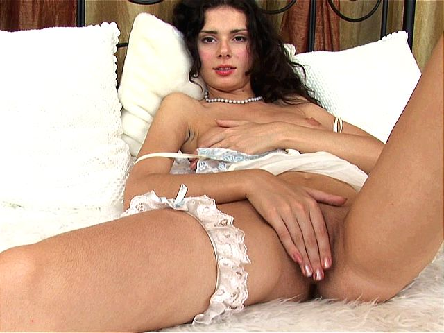 Spirited brunette amateur girl spreading legs and fingering her shaved twat