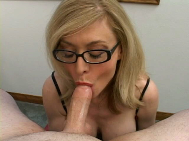 Stimulating blonde granny in glasses Nina Hartley sucking a big shaft