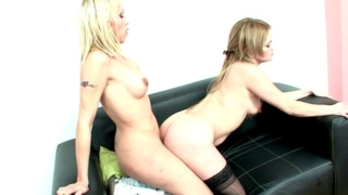 Stimulating blonde shemales Tania And Yanina screwing their tight assholes on the couch