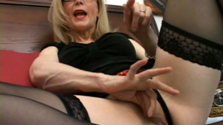 Stockinged blonde granny Nina Hartley showing and rubbing her shaved snatch