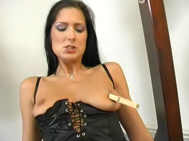 Stockinged brunette slave Caslavova gets tits punished with pegs and double fucked in threesome