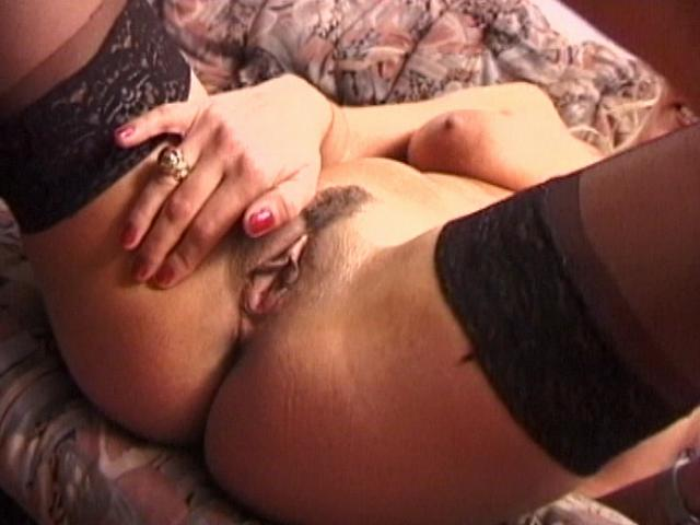 Stockinged wife with fuckable tits rubbing her succulent pussy