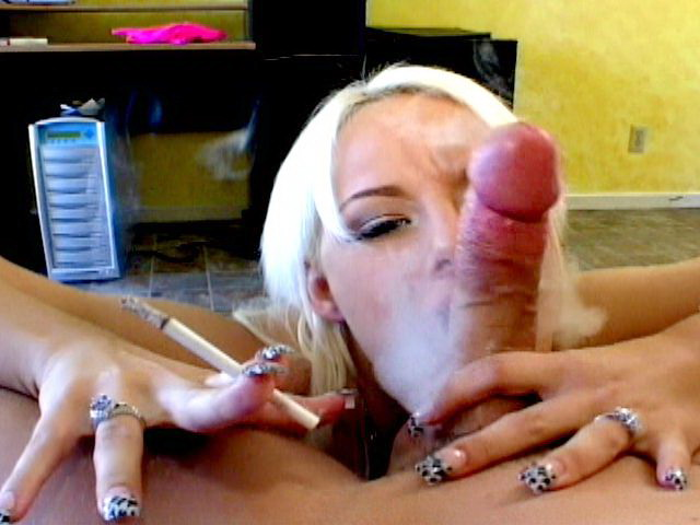 Superb blonde smoker tramp Angel Couture sucking a massive penis on her knees Smokers Erotica XXX Porn Tube Video Image