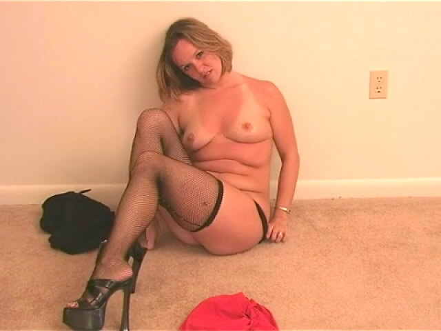 Superb blonde wife Tessa stripping black lingeria and teasing us with her stockings