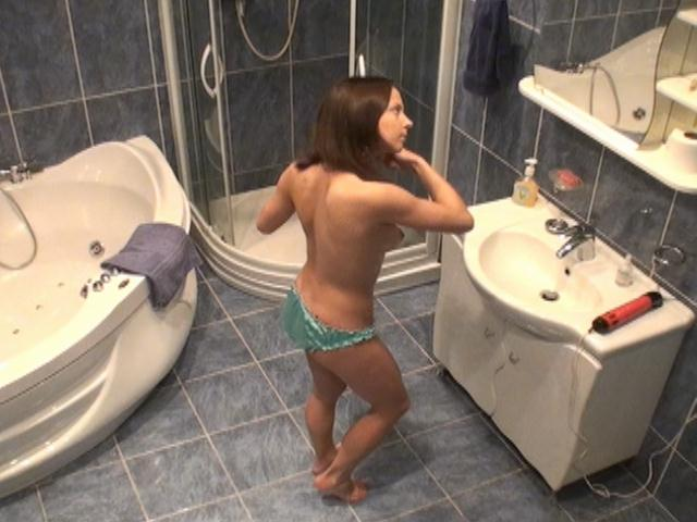 Superb brunette amateur voyeur girl Lilia gets naughty in bathroom on spy camera