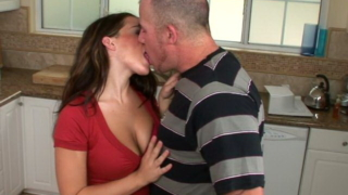 Superb brunette mature nymphet Natasha Nice showing off her big knockers in the kitchen