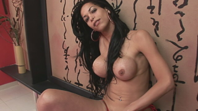 Superb-brunette-shemale-isabella-ferraz-stripping-bra-and-playing-with-her-big-round-jugs_01